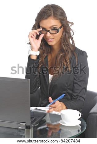Cute young businesswomen at her desk - stock photo