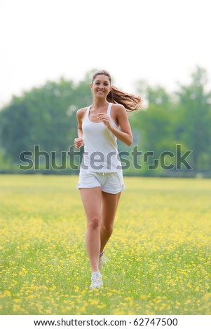cute young caucasian woman running outdoors.Concept of healthy lifestyle - stock photo