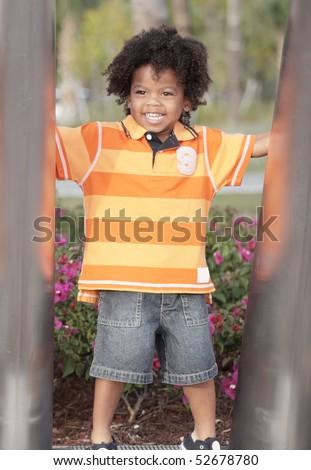 Cute young child in an orange shirt - stock photo