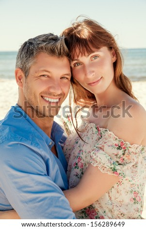 cute young couple lovers on coast