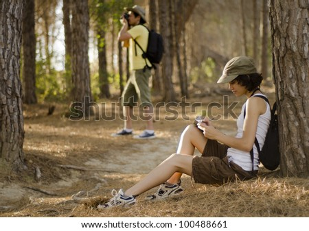 Cute young couple taking a break on a hiking trip