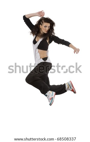 cute young dancer in modern style taking a flying ballet pose over white background