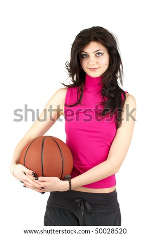 Cute young female in sports uniform holding the basketball - stock photo