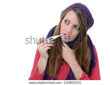 Cute young female using a thermometer in her mouth - stock photo