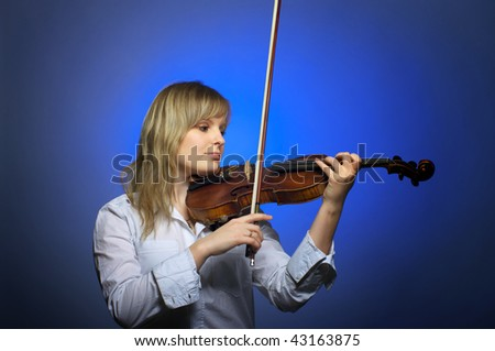 Cute young female violinist at the classical concert - stock photo