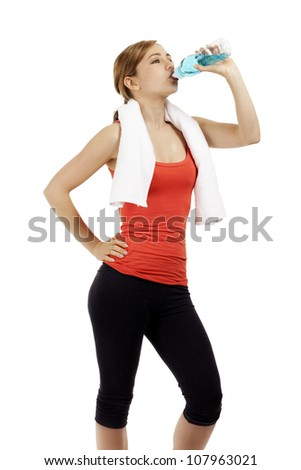 cute young fitness woman drinking water on white background - stock photo