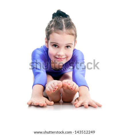 cute young girl doing gymnastics isolated - stock photo