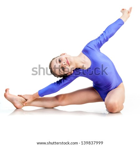 cute young girl doing gymnastics isolated over white background - stock photo
