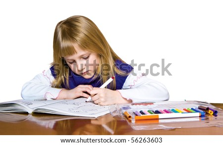 Cute young girl drawing with markers. clipping path