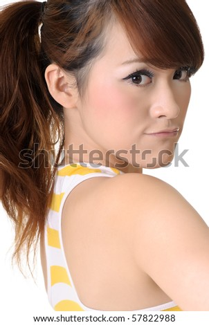 Cute young girl face, closeup portrait of Asian on white background.