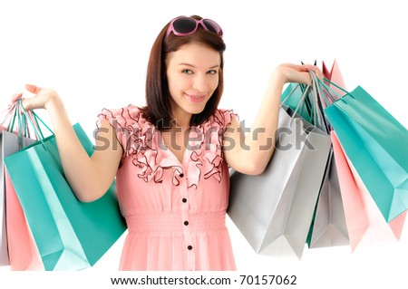 Cute young girl goes shopping - stock photo