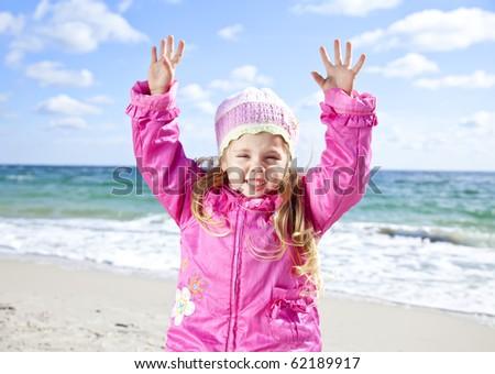 Cute young girl having fun on the beach - stock photo