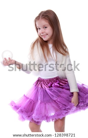 Cute young girl holding decorative white ball