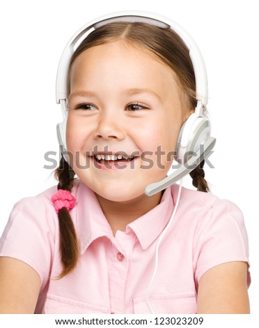 Cute young girl is working as an operator at helpline talking with customer using headset, isolated over white - stock photo