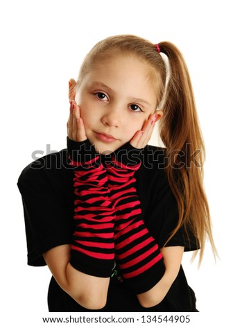 Cute young girl isolated on a white background, wearing pirate punk gloves - stock photo