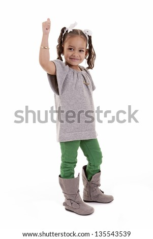 cute young girl showing thumbs up isolated on white background