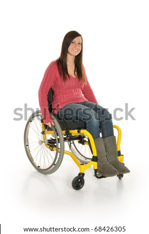 Cute young girl smiling in wheelchair - stock photo