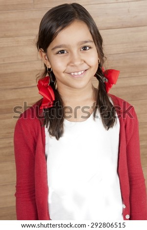 Cute young girl smilling, indoor photo . - stock photo