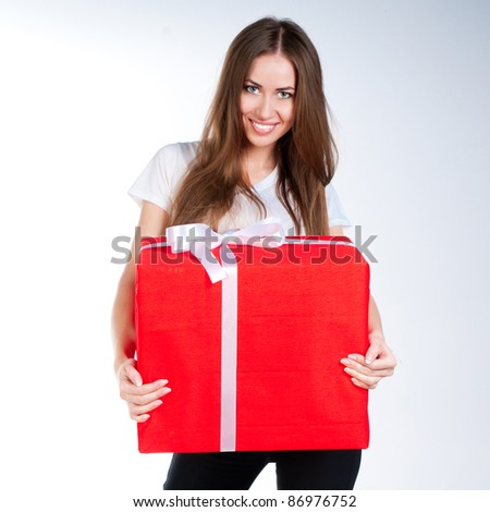 cute young girl with a gift on a white background - stock photo