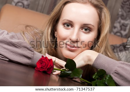 Cute young girl with a rose - stock photo