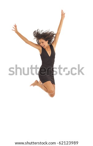 Cute young girl with black dress jumping energetically - stock photo