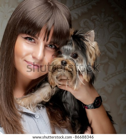 Cute young girl with her Yorkie puppy - stock photo
