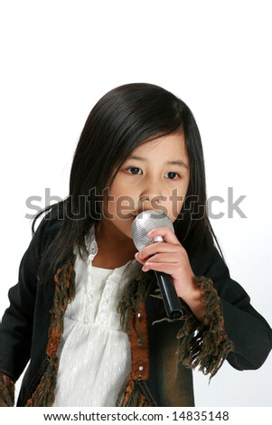 Cute young girl with microphone singing - stock photo