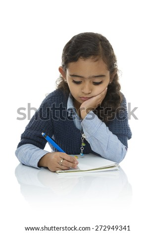 Cute Young Girl Writing Isolated on White Background - stock photo
