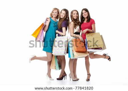 Cute young girls with their bags on a white background - stock photo