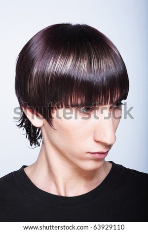 Cute young guy with fashion haircut - stock photo