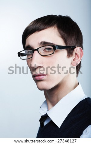 cute young guy with fashion haircut wearing glasses - stock photo