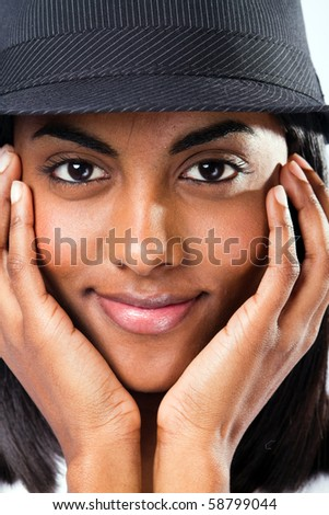 cute young indian girl face closeup with a hat - stock photo