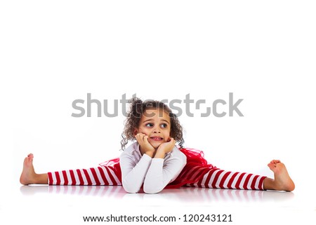 Cute young kid stretching her legs, doing the splits. - stock photo