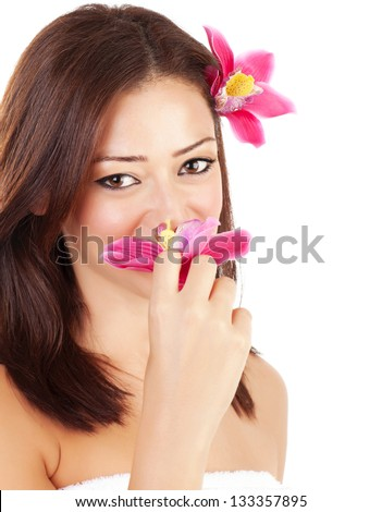 Cute young lady enjoying flower smell, closeup portrait of pretty woman with pink orchid in head isolated on white background, luxury spa salon - stock photo