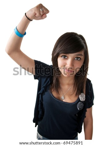 Cute young latino girl on white background making a fist - stock photo