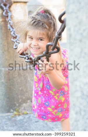Cute young little girl smiling in an outdoor day - stock photo