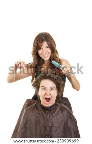 cute young male chubby child kid or boy shocked with face expression with long hair at smiling female hairdresser cutting his hair while he sitting in chair with bosco, fanny photo - stock photo