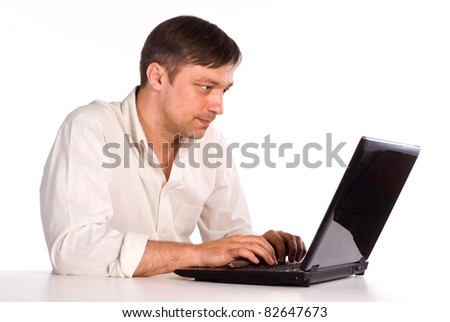cute young man with a computer on white