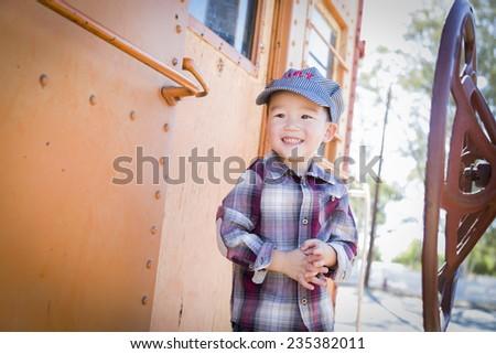 Cute Young Mixed Race Boy Having Fun Outside on Railroad Car. - stock photo