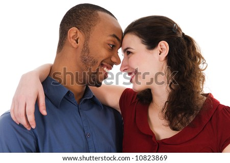 cute young multi ethnic couple in love on white - stock photo