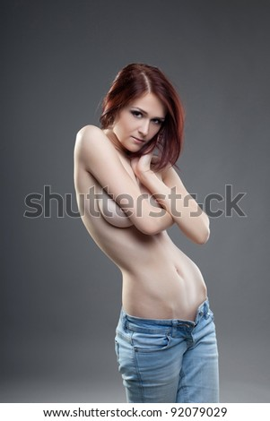 cute young naked brunette girl portrait in jeans - stock photo