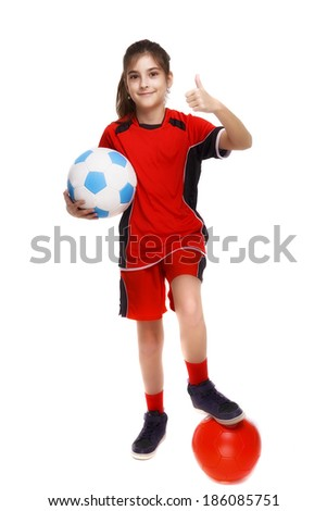 Cute Young Soccer Player with ball isolated on white