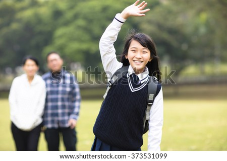 cute young student girl with parent in school - stock photo