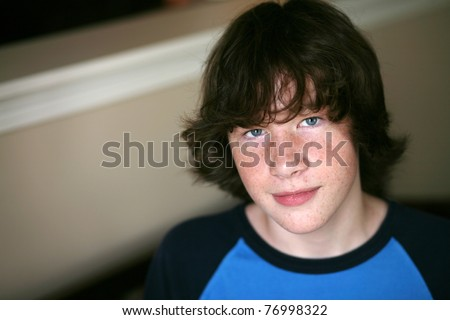 cute young teen boy in natural light - stock photo
