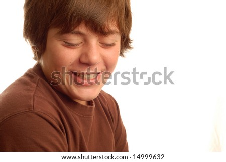 cute young teen boy with a bashful grin - stock photo