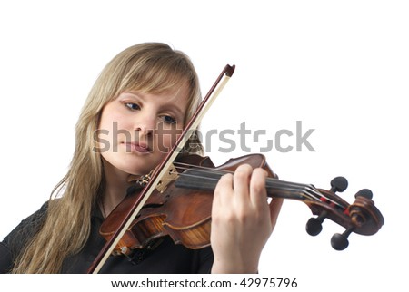 Cute young violinist playing violin over white background - stock photo