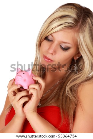 cute young woman holding a little pink piggy bank