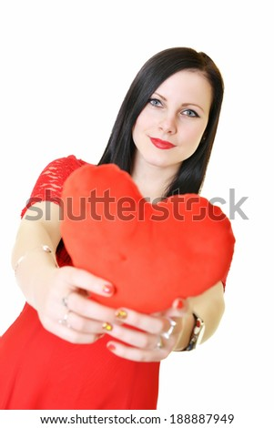 Cute young woman holds a heart symbol