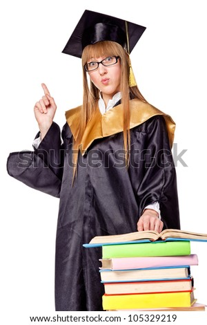 Cute young woman in a graduation gown. Isolated over white