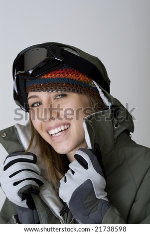 Cute young woman in snowboard or ski clothing,